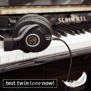 Headphones and feather on piano